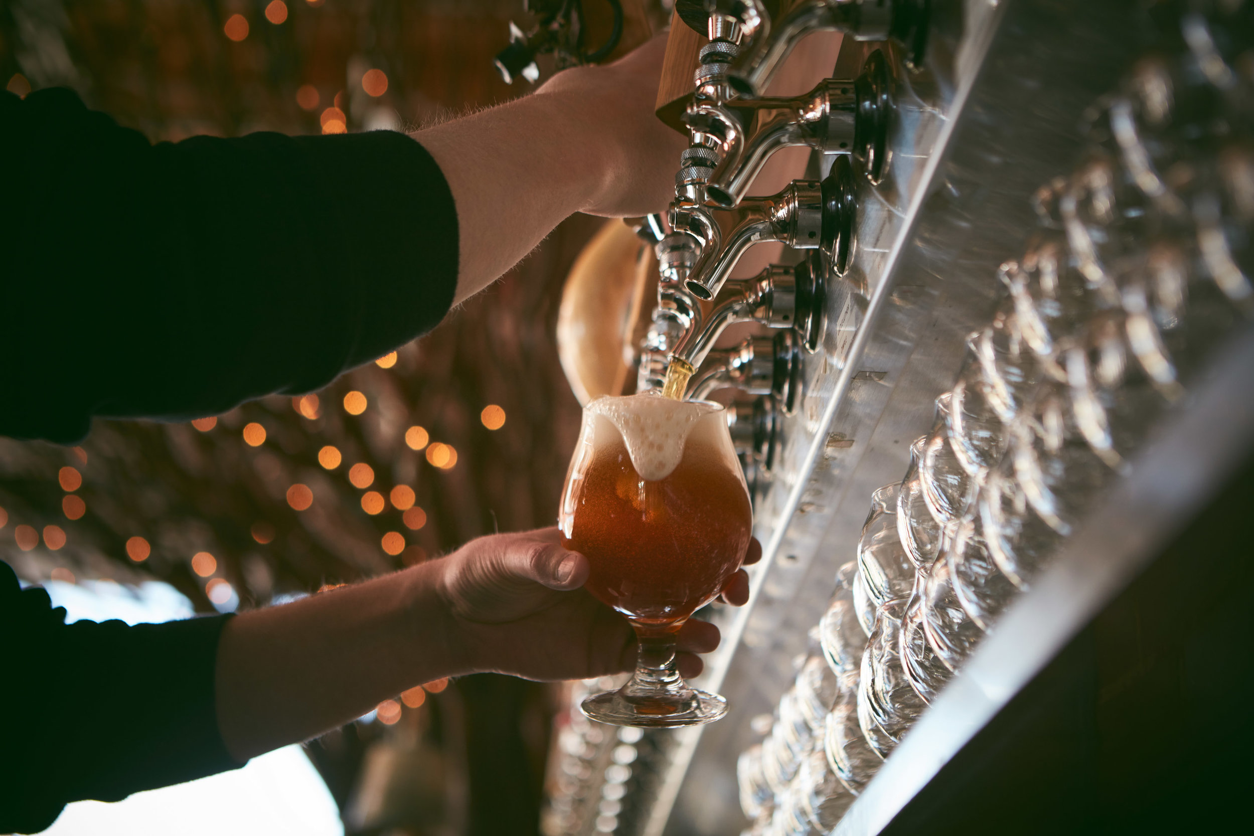 Photo 2: Photograph of beer being poured at Dry Ground Brewery in Paducah, Ky.