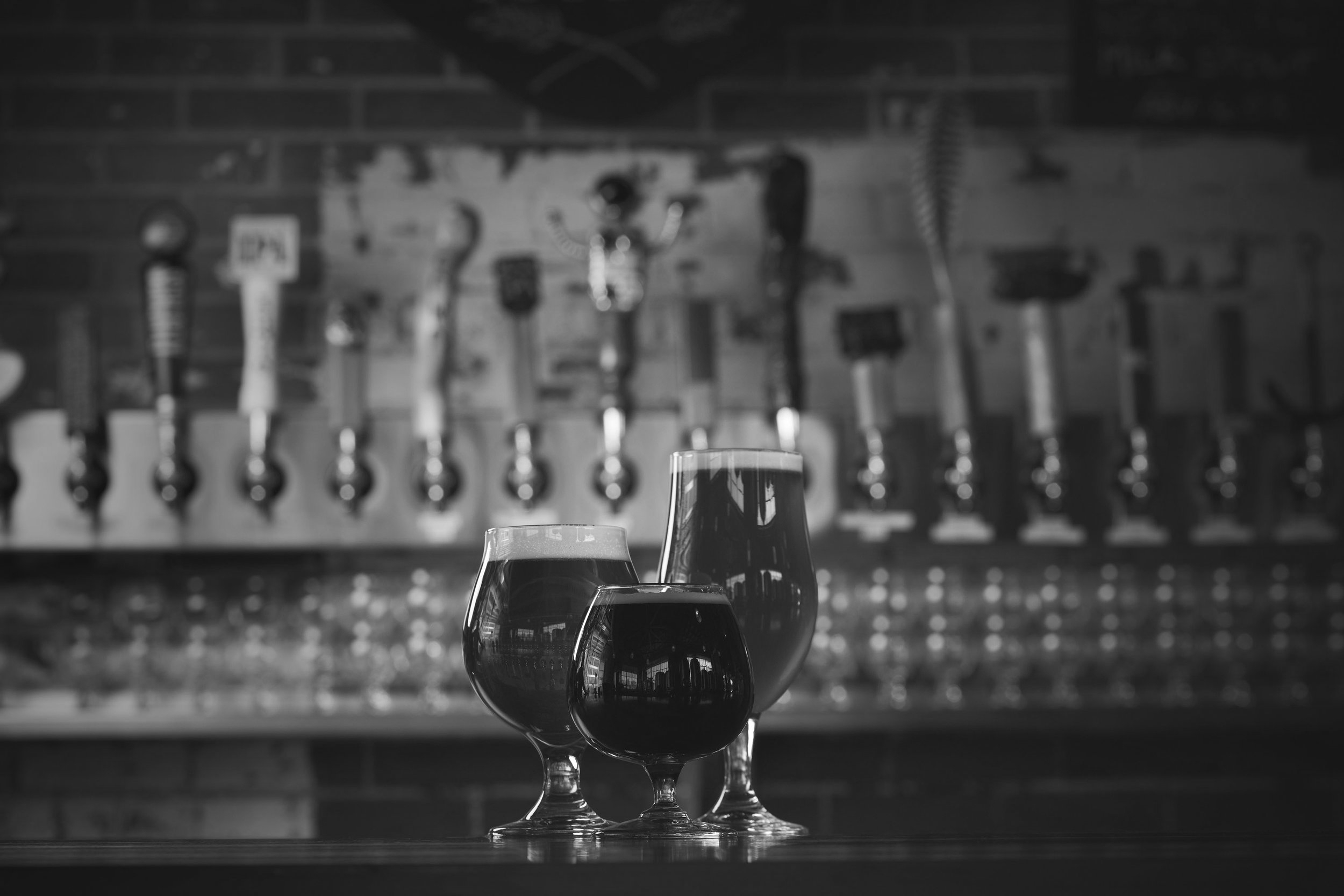 Photo 5: Photograph of several beers and glass options offered by Dry Ground Brewing.