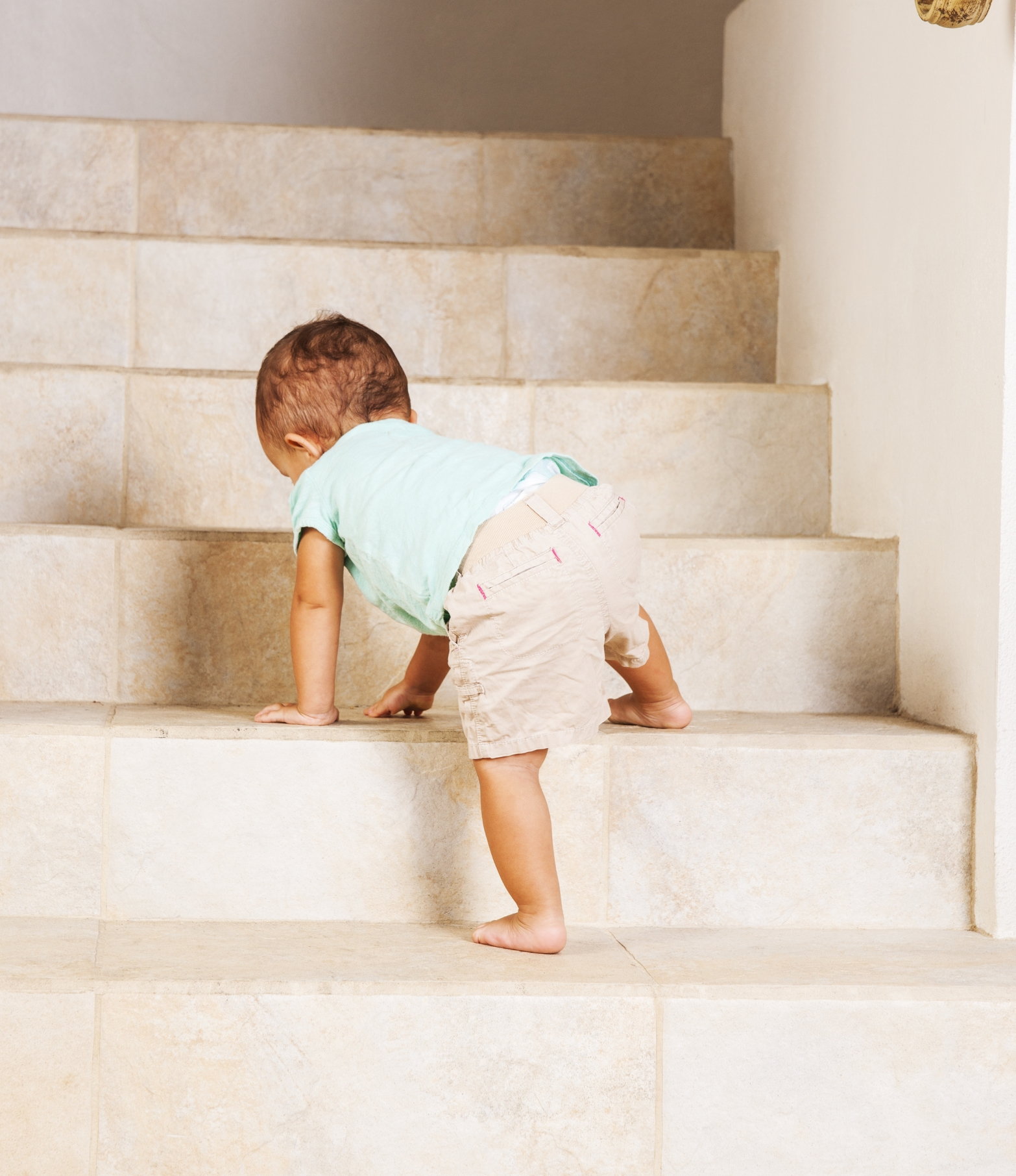Preventing falls down the stairs with stair gates for babies.