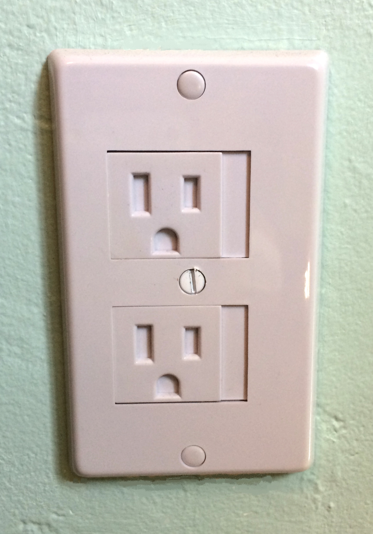 Electrical outlet plate cover with one screw installation.