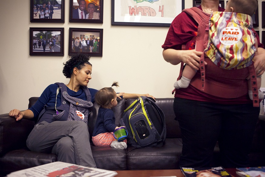 Zaida Espada and her 11 month-old daughter Zoe helped deliver petitions and personal stories to the D.C. Council on Thursday in support of the DC Universal Paid Leave Act. (Emily Jan / National Journal)