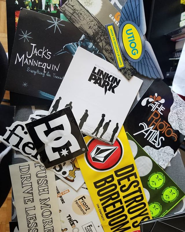 Most of my sticker collection aka a time capsule 👵🏾⏳ #dc #volcom #vans #paramore #franzferdinand #linkinpark #mia #raconteurs #neff #burton #peta2 #ovr #arcticmonkeys #vampirefreaks #journeys #dinosaurjr