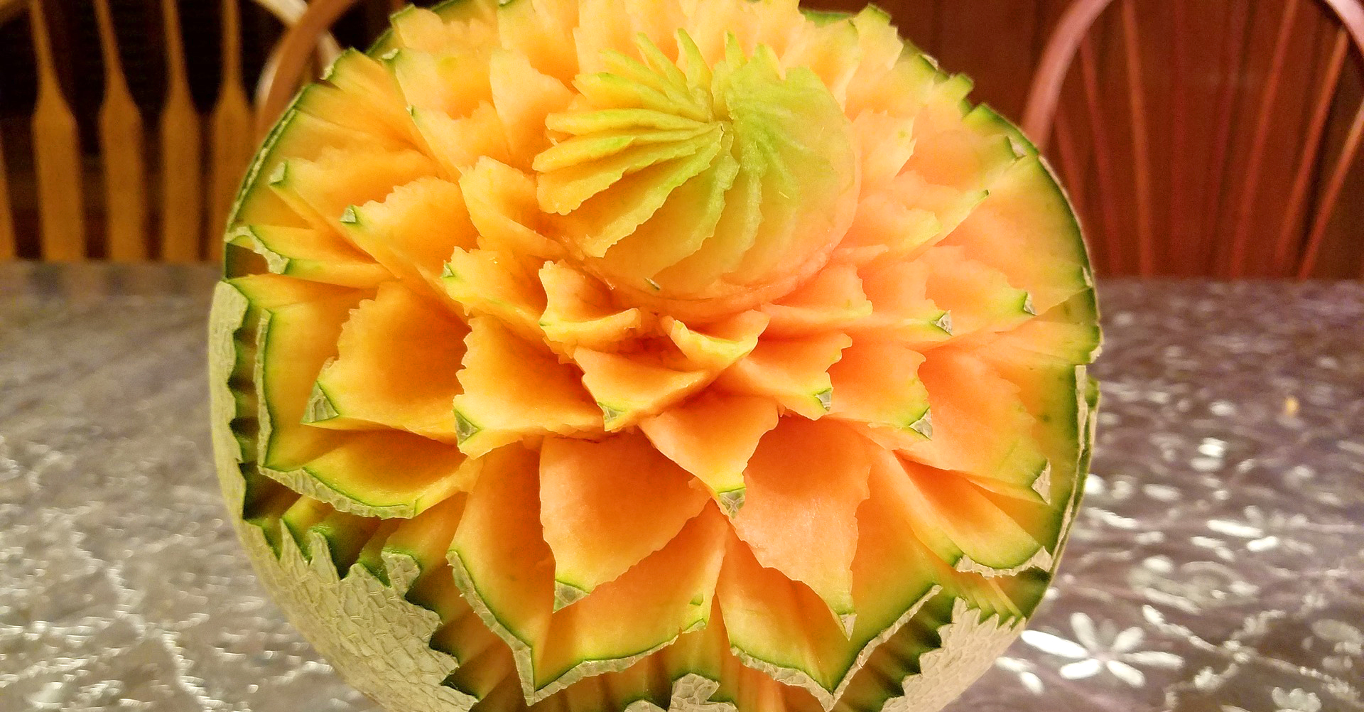 Carved cantaloupes can create a beautiful (and edible) centerpiece.