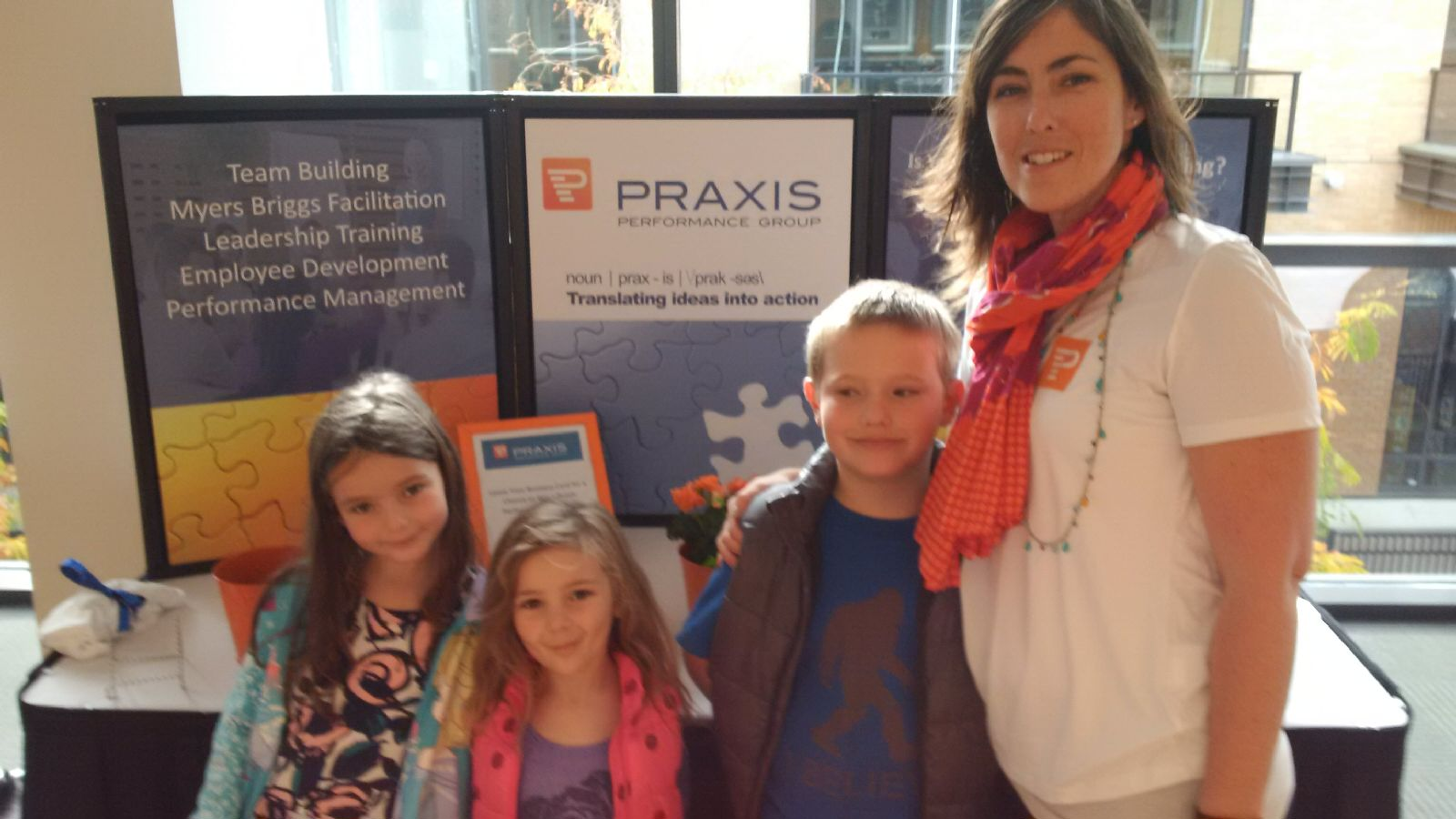 Stewart family representing the Praxis booth at the PowHertalks Nanaimo event