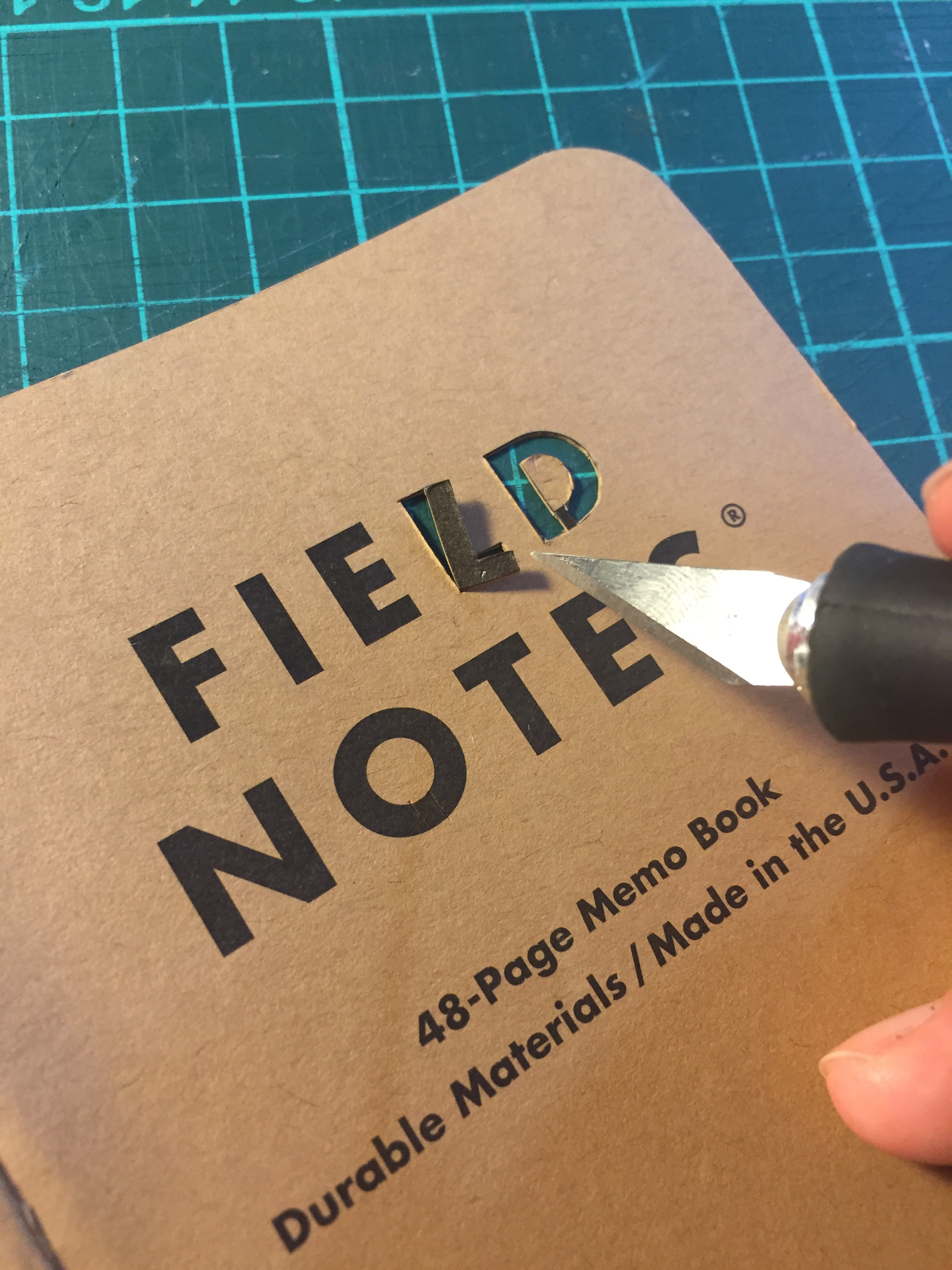 Next I took one of the plain Kraft notebooks - I really wanted to make something of the iconic Field Notes text on the front - I decided it would look really good to cut out the letters and stick some funky tape behind it