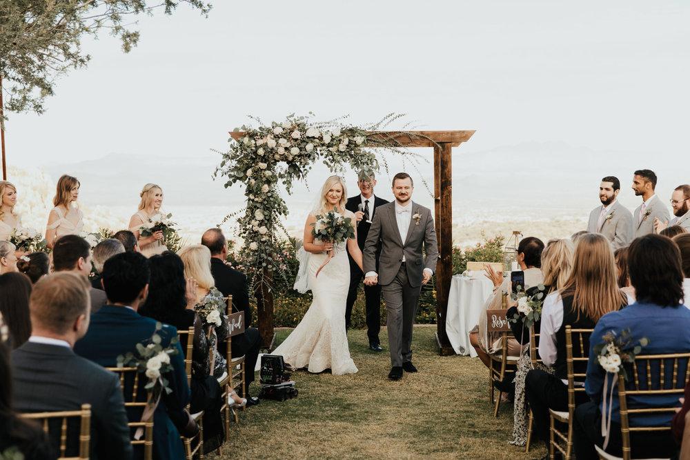 1209-creative-florist-romantic-copperwynd-wedding-arizona-bride-groom-ceremony-exit.jpg