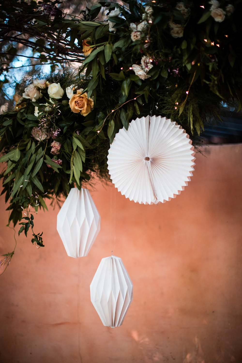 1209-creative-wedding-florist-madison-wisconsin-ceremony-arch-paper-lanterns.jpg