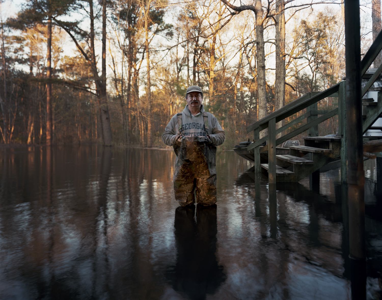 Jody in the driveway of his house during a flood  Effingham County