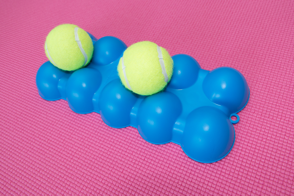 The Back King Angled Top Side 2 Separated Tennis Balls