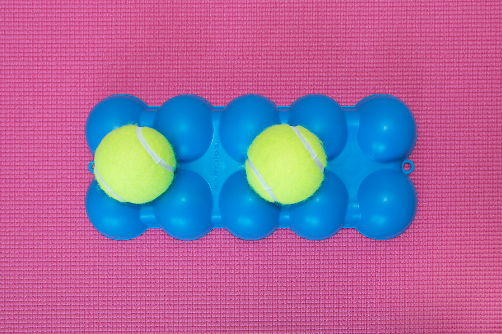 The Back King - Top Side 2 Separated Tennis Balls