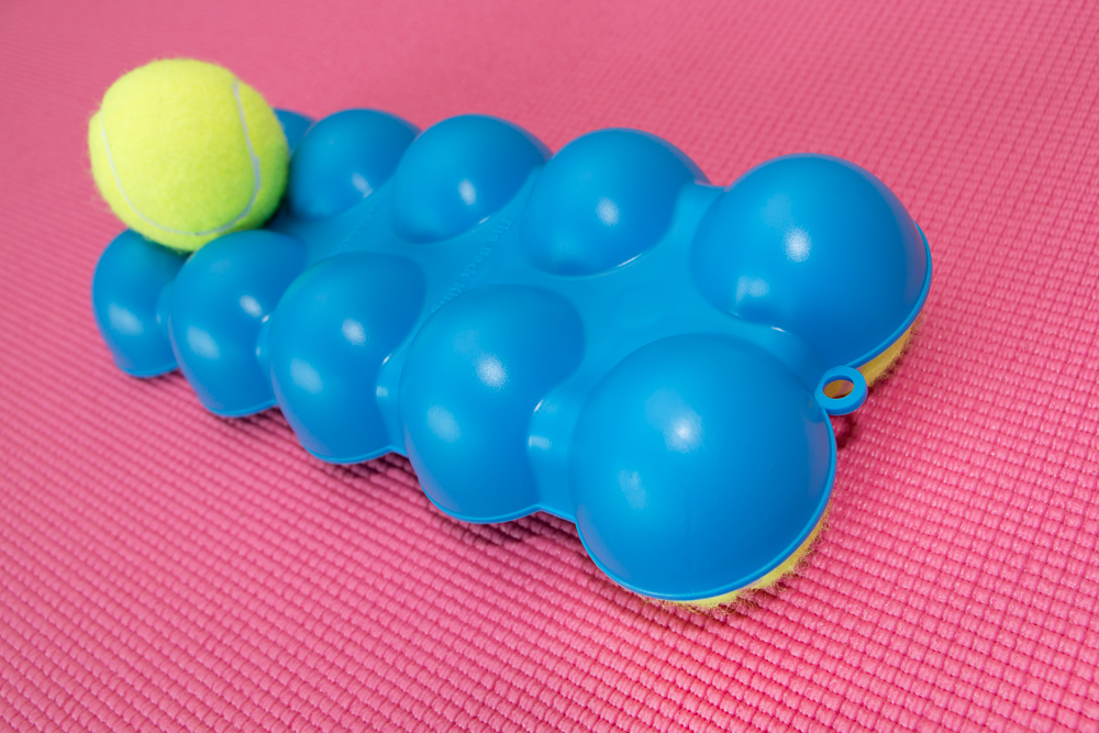 The Back King Angled Top Side 1 Tennis Ball with 2 on Bottom