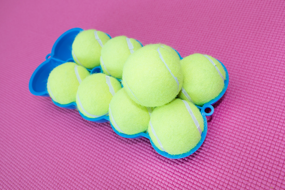 The Back King Angled Bottom Side 9 Stacked Tennis Balls