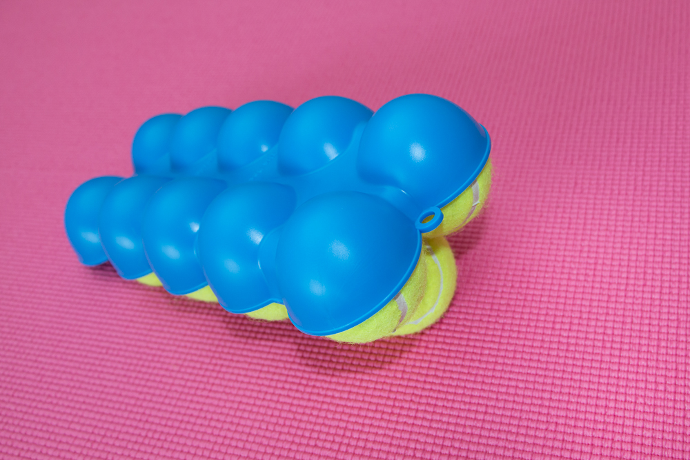 The Back King Angled Top Side 9 Stacked Tennis Balls