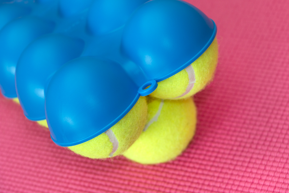 The Back King Angled Top Side 9 Stacked Tennis Balls Close-Up
