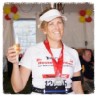 Diana celebrating completion of 2011 Chicago Marathon!
