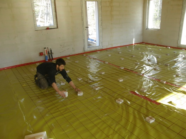 Preparing for the concrete floor; Stego vapor barrier and remesh.