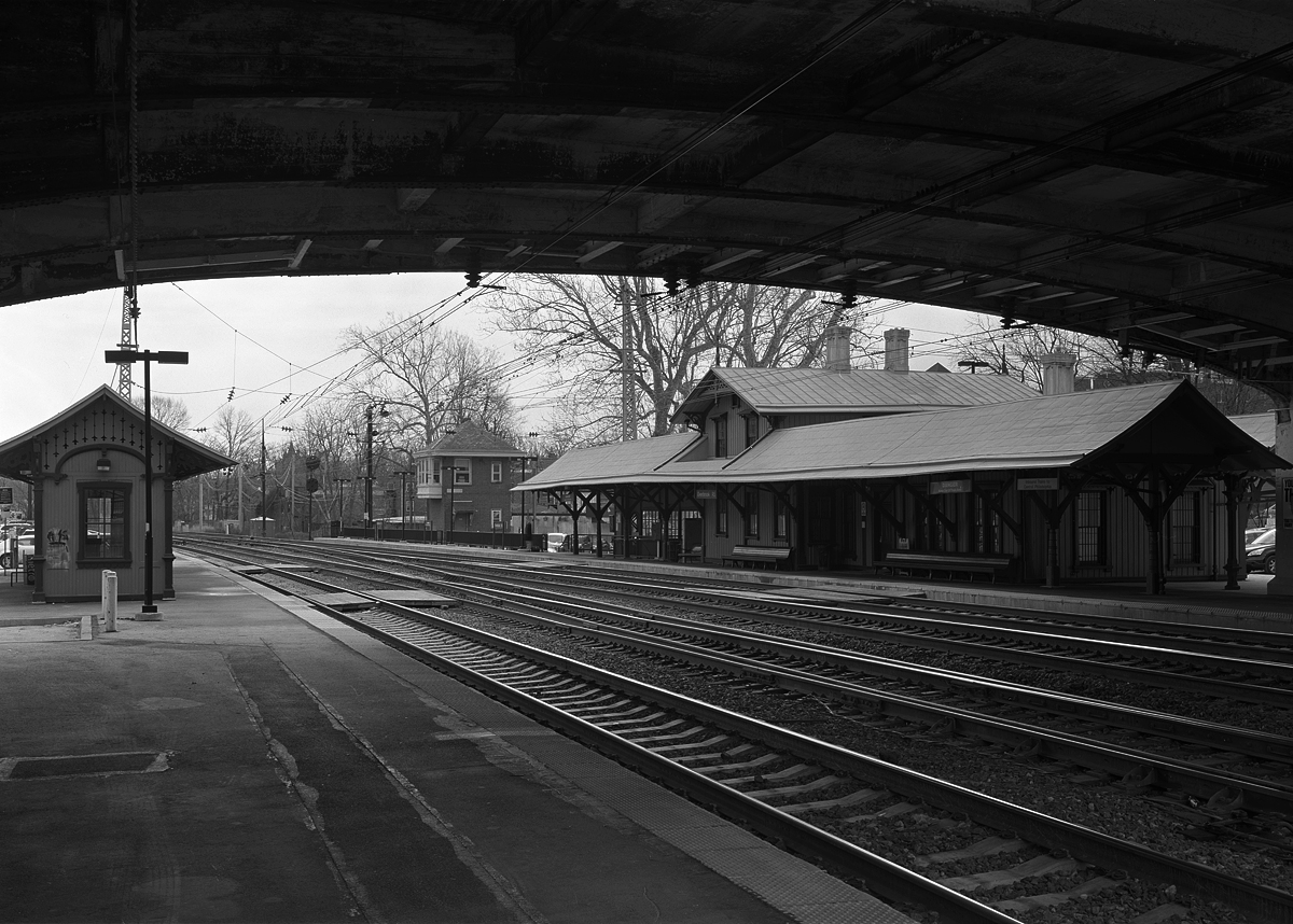 "Overbrook Station, a commuter stop on Philadelphia's western edge typifies what initially drew me to document the former PRR. Among a historic station, signals and switch towers operates one of the most recently upgraded Amtrak routes in the Northeast, the Keystone Corridor. This route was originally the main line west from Philadelphia and played a big part in shaping the surrounding landscape known locally as ""The Main Line""."