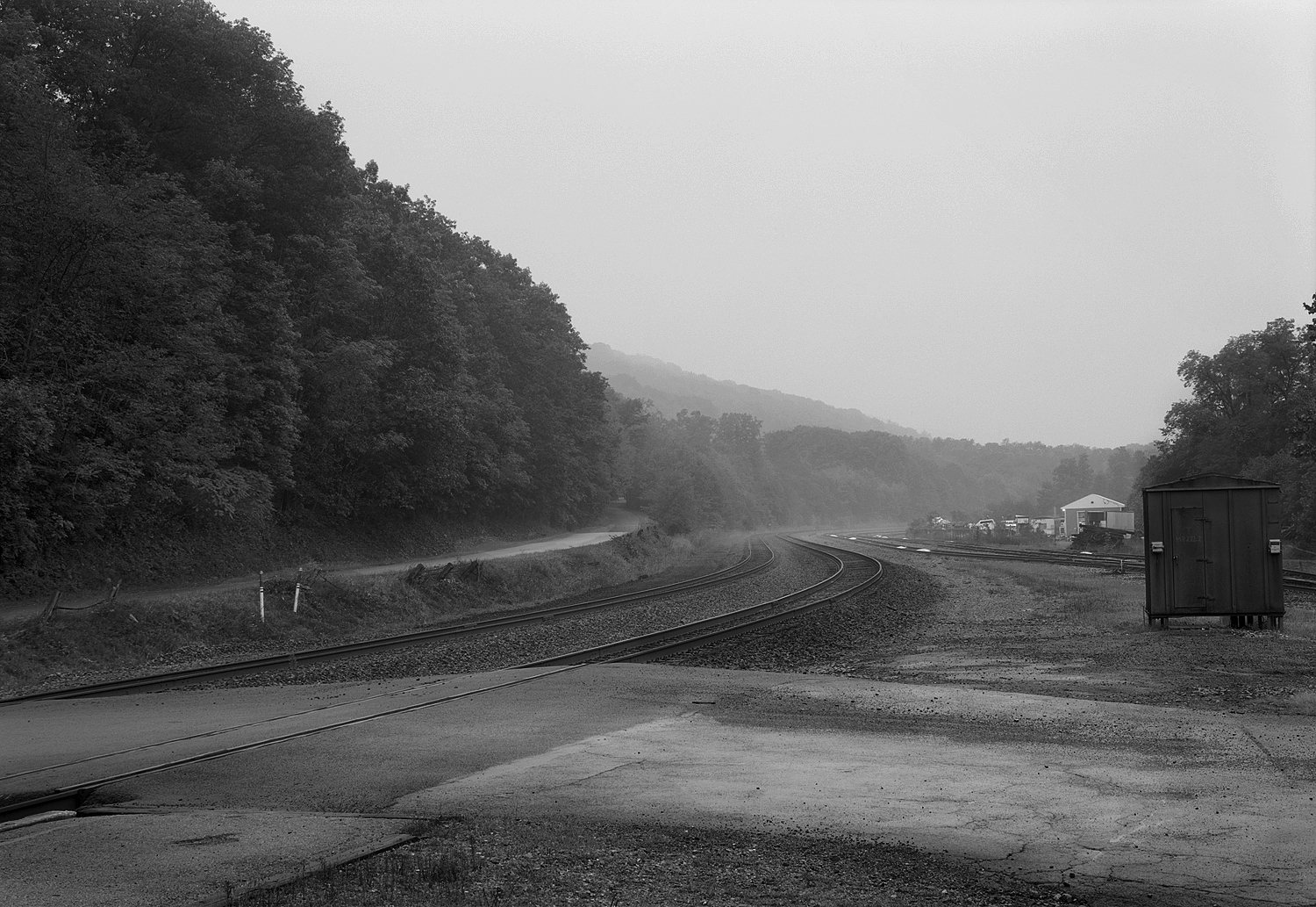 Just West of the of the former PRR Tyrone train station and current Amshack the Mainline made a sharp turn South heading down the Valley to the well know City of Altoona. This simple study looks across Spruce St and the Mainline at dusk in September of 2008. To the right is the yard trackage and connection to the Bald Eagle Branch, a line that provided a alternative route to the Mainline and access to the Upper Susquehanna Valley.