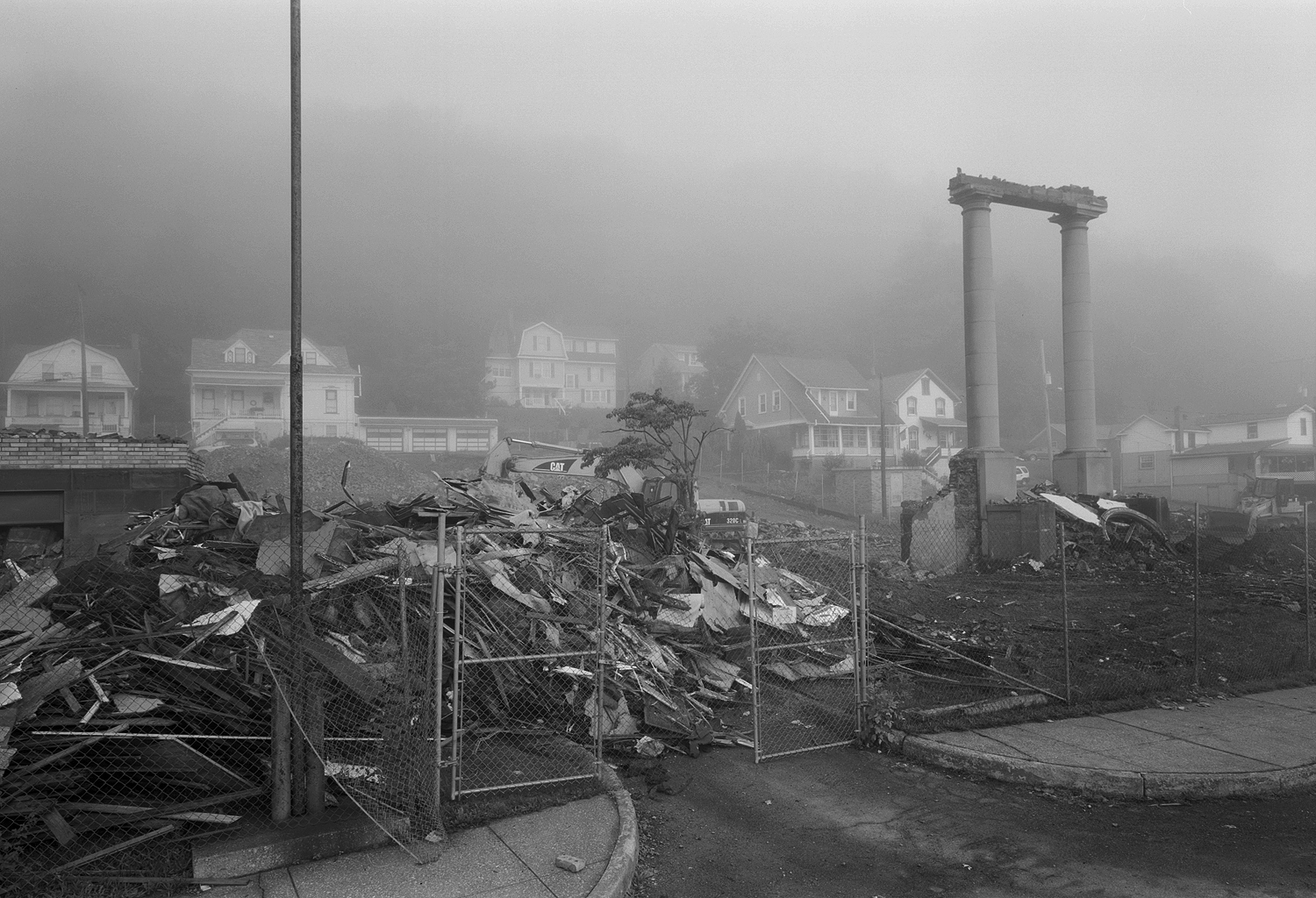 Former 1911 Lincoln High school of Tyrone Pennsylvania,  Fall of 2008. Made just a few days before its complete demise. The gloomy fog is fitting for this image of what remained of the beautiful relic.