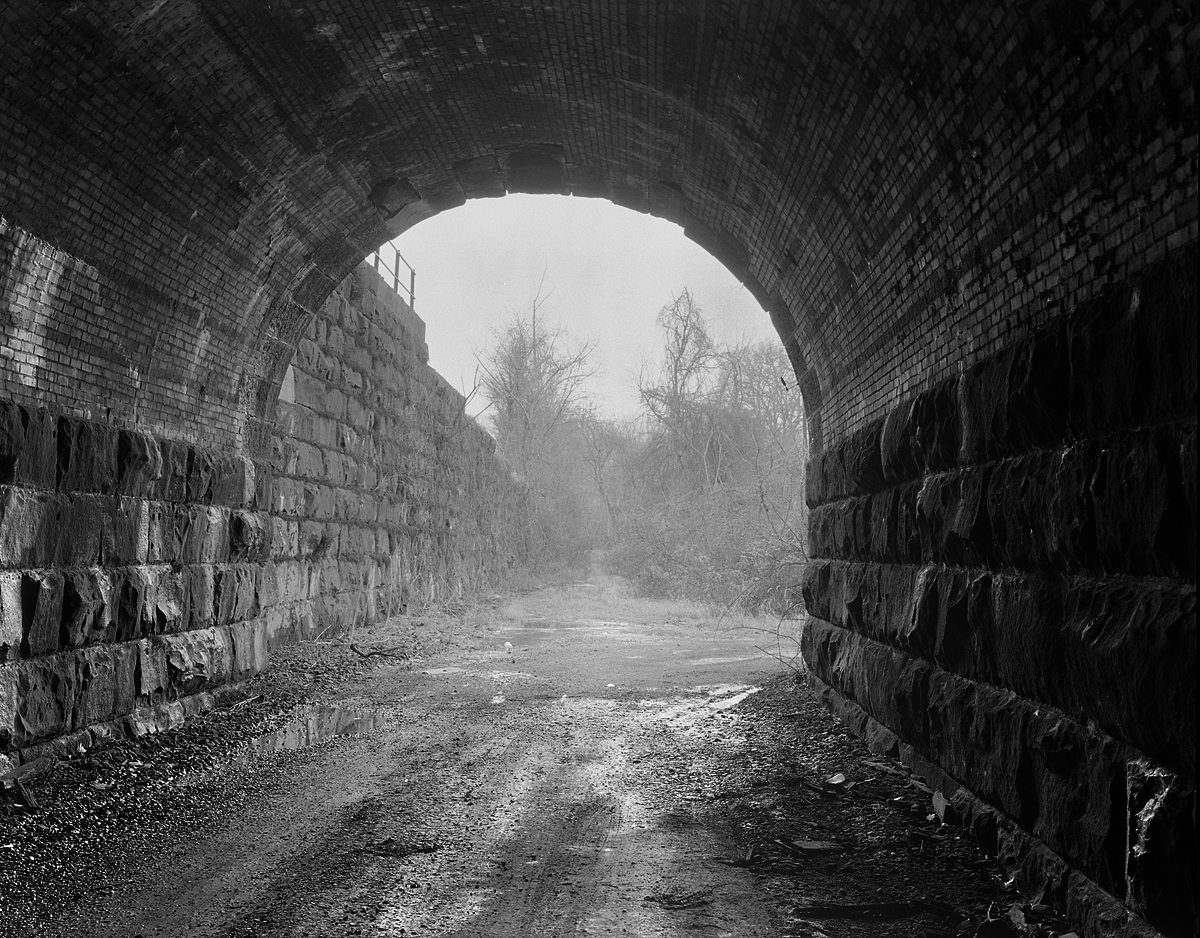 "View looking north (railroad west). Abandoned ""D"" track Tunnel under the Westbound Mainline from Harrisburg at Rockville West."