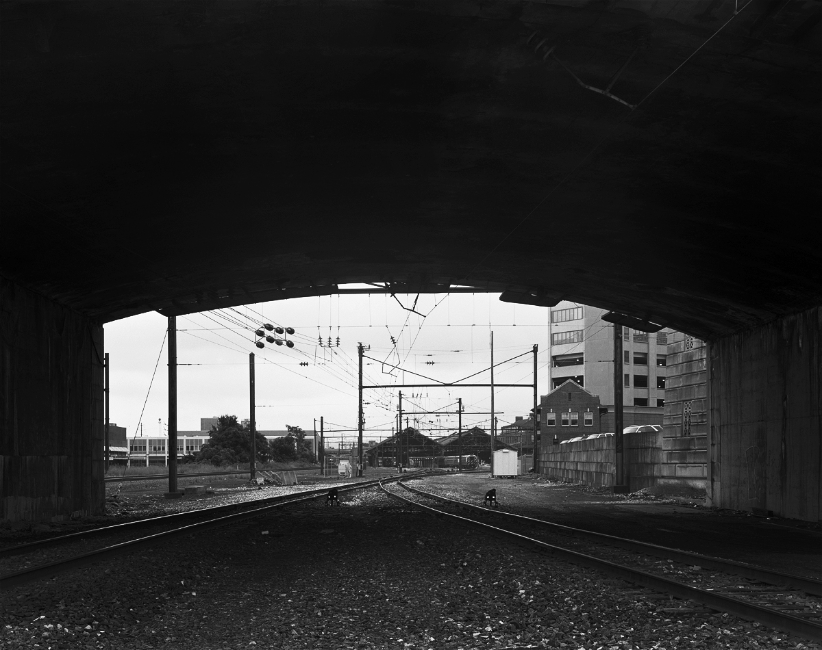 Framed by the State Street Bridge, the remaining signals that protect Amtrak movements entering the train station from a connection with Norfolk Southern stand guard. Harris Tower stands on the right, all remaining operations are handled by State tower in the train station.