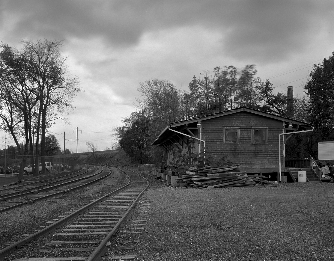 Former PRR Freight Station located along the original main line alignment prior to the 1915 grade separation through the area. From the left to right the tracks are as follows: Former Klein Chocolate Plant siding, the main industrial lead, and public delivery track/ freight house lead. Note the Main Line on the embankment with switchback siding dropping down onto the old main. The freight house was demolished early this year to make way for much needed parking at the rehabilitated Elizabethtown Amtrak Station. (Inset) 1945 Segment of a PRR CT1000 which lists all line side industries on the PRR.
