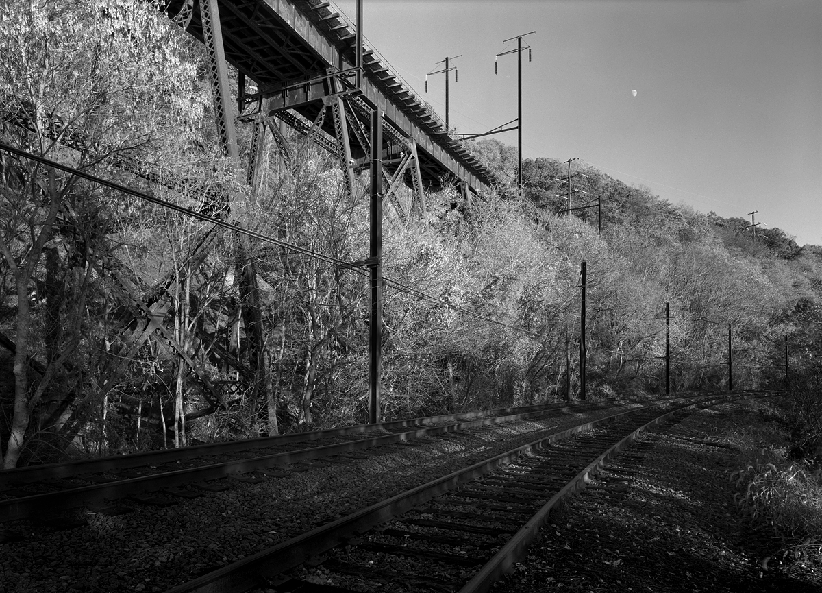 View from the Port Road looking to the South. There is a passing siding here that ends just to the north of the Conestoga Bridge, giving the appearance of double track. Most of the Port Road south is single track with passing sidings. The A&S Bridge stands silent today, with no rail activity since 1988.