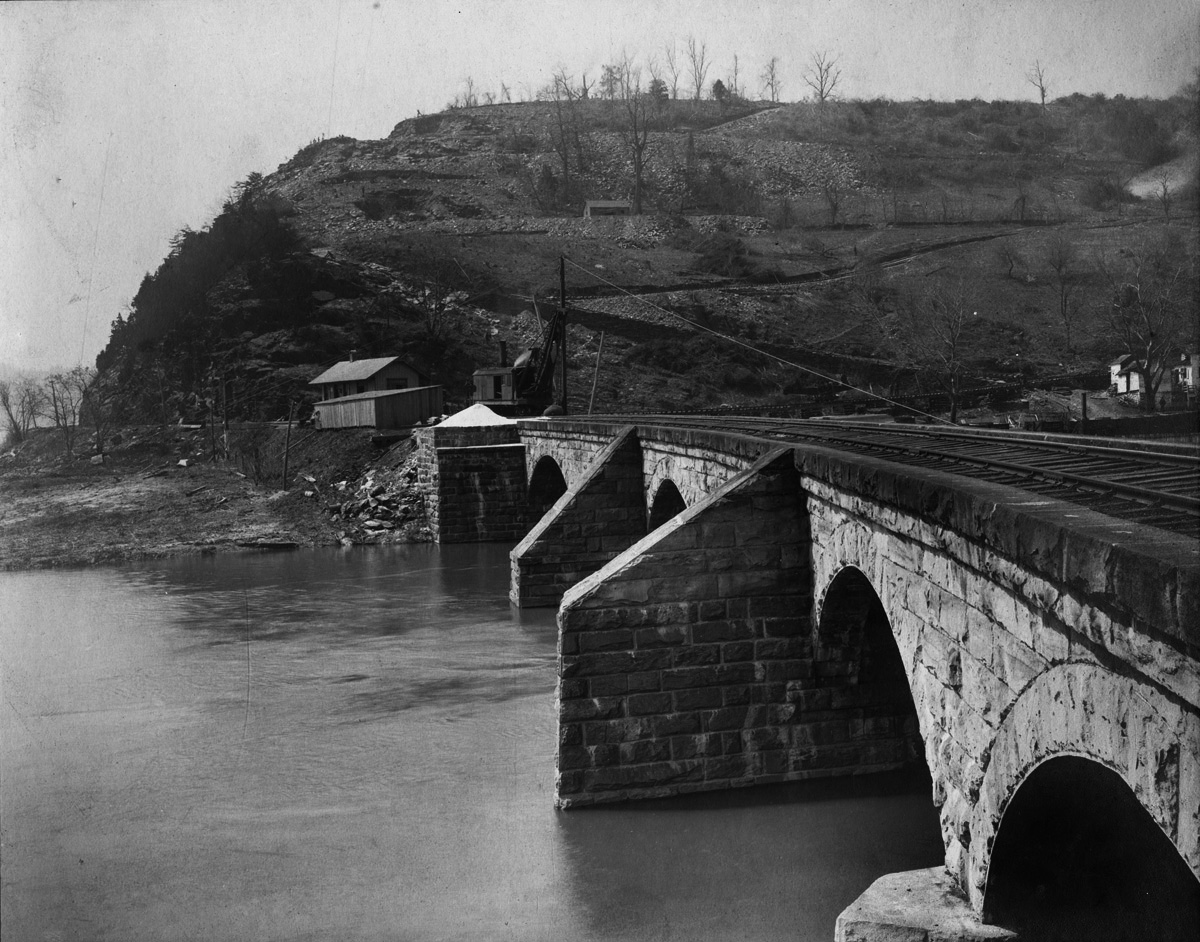 Rare view of the original Columbia and Port Deposit Bridge spanning the Conestoga River. This bridge was destroyed by floods in 1904 during the construction of the A&S bridge. It was decided to replace it with a new span rather than rebuild the remains of the stone bridge. Collection of the Lancaster County Historical Society