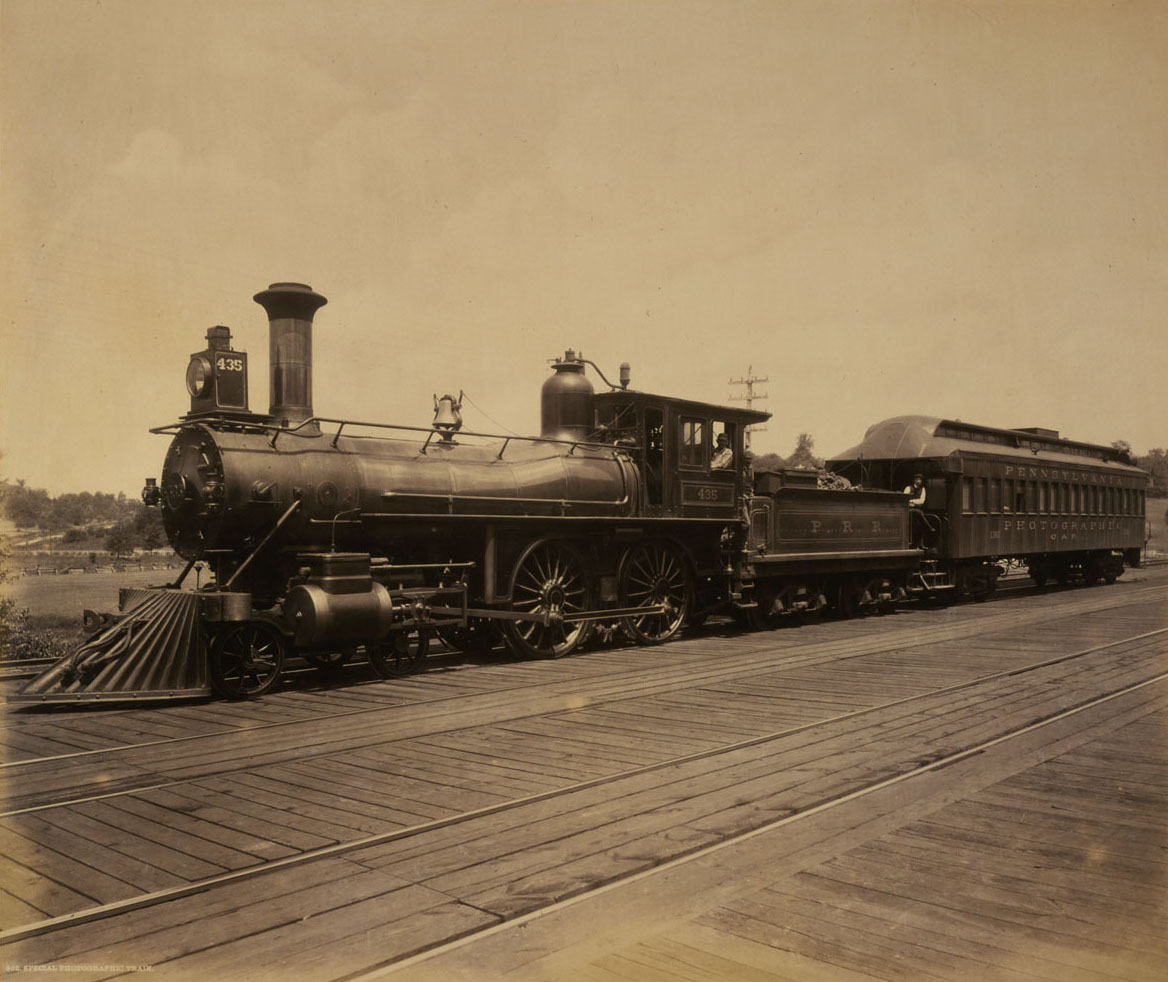 Plate 202: Special Photographic Train. This image depicts the locomotive and car outfitted for Rau's commissions of 1891 and 1893. The coach was specially outfitted with a complete darkroom, living quarters and a platform on the roof for Rau to set up his mammoth plate view camera to make images along the railroad. Collection of American Premier Underwriters, Inc.