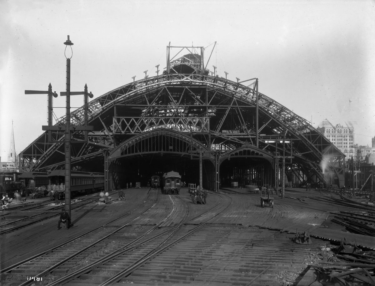 This image illustrates the changes to Broad Street Station during the 1892 modernization. Note that the railroad left the original canopies in place where possible to protect passengers until the new shed was complete. Despite the heavy construction the railroad would not allow the project to interrupt passenger service. This was typical practice on the Pennsylvania Railroad. William N. Jennings photograph, Collection of Library Company of Philadelphia.