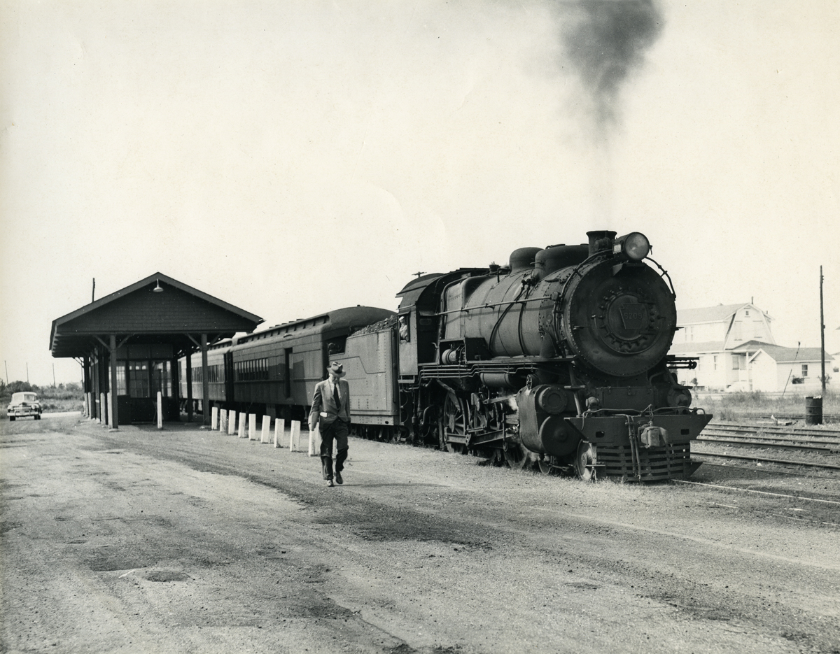 A lone commuter detrains from a Pennsylvania-Reading Seashore Lines train at the Gardens Station on the Ocean City Branch, October 1950. This facility was located between North Street and Battersea in the neighborhood along modern day Sindia Road and was abandoned in late 1958. It was photographs like this that captivated me at an early age and today   hangs in my office to remind me of my early curiosity of railroad history. Photograph by Robert L. Long, collection of the author.