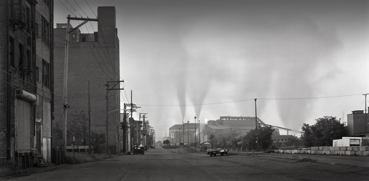 On a damp morning smoke and steam rise from the Edgar Thompson Works in this view from Woodlawn Street in Braddock, Pennsylvania. Much of the commercial and residential  infrastructure of this section is in disrepair leaving the remaining residents among relics of a once thriving community that looked to mill for life.