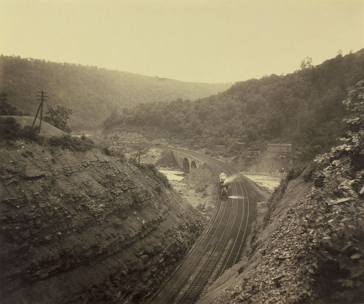 No. 6 Bridge from Deep Cut, Pittsburgh Division. Image from Rau's 1891 commission showing the fresh re-construction of the main line through the Conemaugh River Valley that was decimated by tragic floods just three years before. William H. Rau photograph, Collection of American Premier Underwriters, Inc.