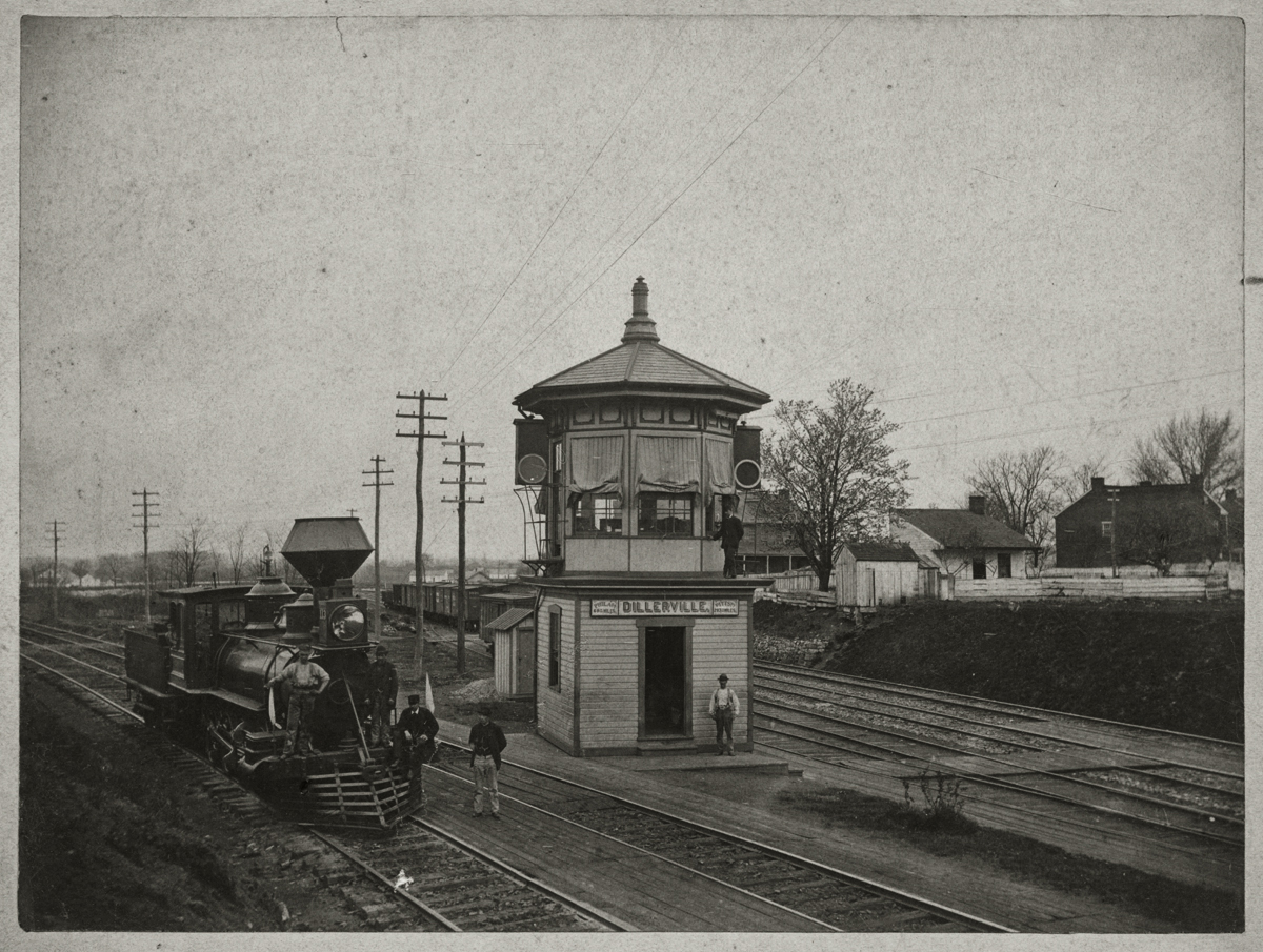 This view looks west depicting the first tower at Dillerville around 1880. To the left is the Columbia Branch of the former P&C  and to the right is the former H&L to Harrisburg. Note the sign on this early wood frame octagonal switch tower which proclaims an exact distance of 69 and 30/100 miles to Philadelphia and 283 and 70/100 miles to Pittsburgh. Another noteworthy detail is the early signals utilized to govern traffic at the junction. As evident from Rau's photo in 1888 this junction would be greatly reconfigured with the addition of the Lancaster Cut-off. Photographer unknown, image courtesy of LancasterHistory.org, Lancaster, Pennsylvania.