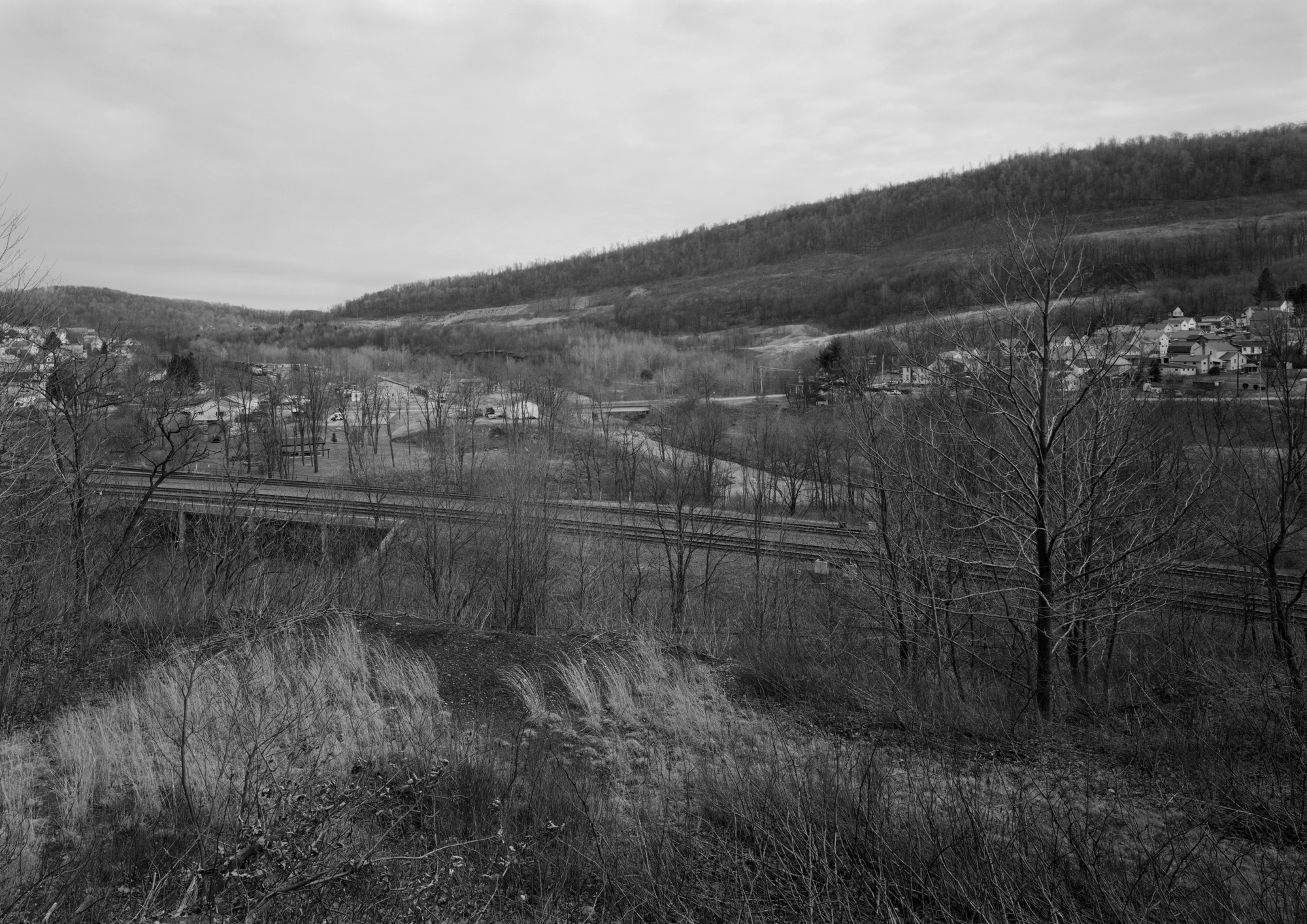 Taken from the former Portage Railroad alignment in neighboring Ehrnfield PA, the viewer can see the South Fork Valley carved by the Little Conemaugh River of which the town of about 1100 is named. The river played host to America's worst disaster, the Johnstown Flood in 1889, which the PRR played an instrumental role in the recovery and rebuilding of the area.