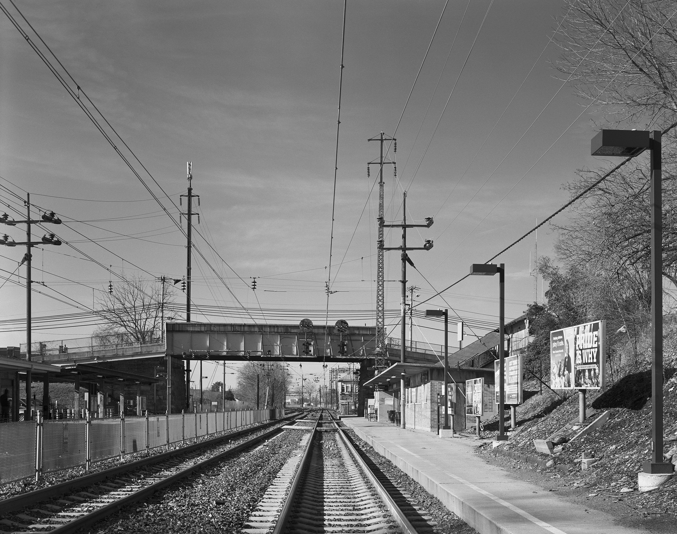 The western terminus of the 1915 electrification was Paoli, Pennsylvania just 20 miles west of Broad Street Station. Here in a modern view we look west toward the interlocking tower and former shop facility used to service the MP54 MU cars. Telltale details of the 1915 electrification include both the lattice style and tubular trolley poles that support the catenary system. Note: This photograph was taken with Amtrak permission under watchman protection, the author does not condone any type of trespassing on railroad or private property.