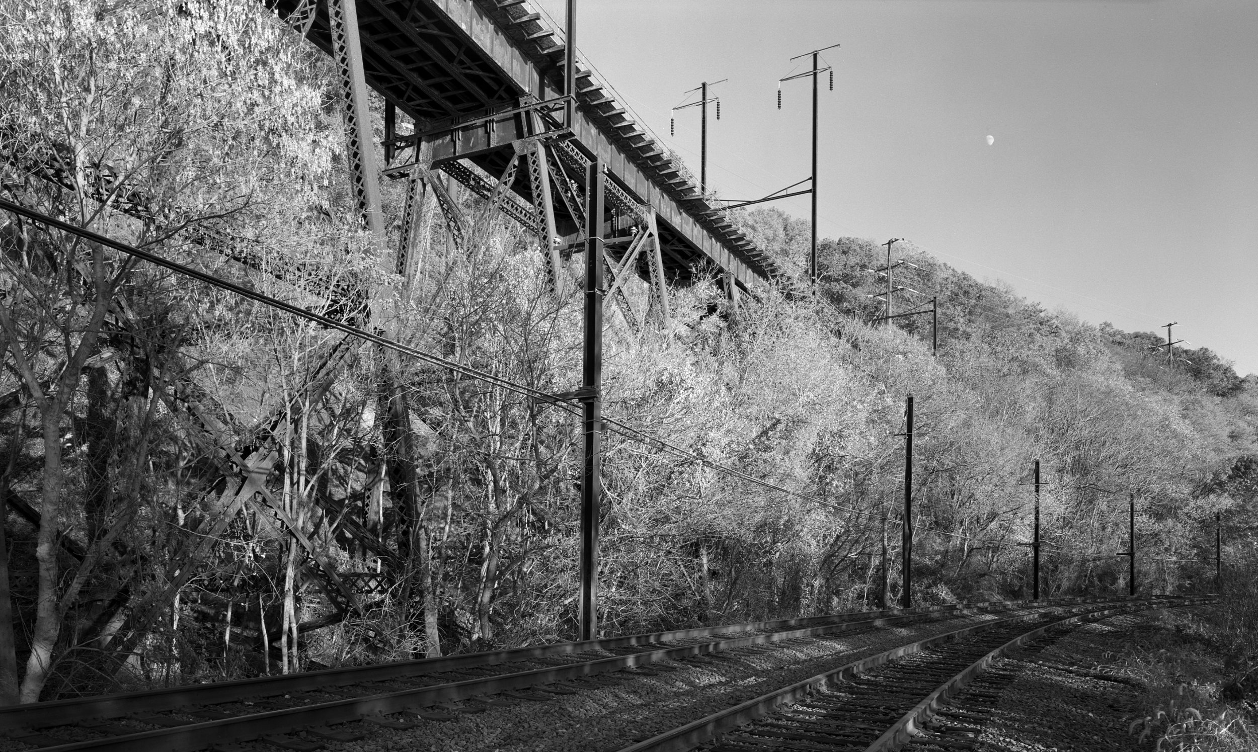 The massive Safe Harbor Bridge was just west of the temporary block station named Fire which was put into service in 1959. The block station and crossovers were located on the A&S Branch up on the embankment pictured here in the top right of the image, the Columbia & Port Deposit Branch is the line in the foreground.