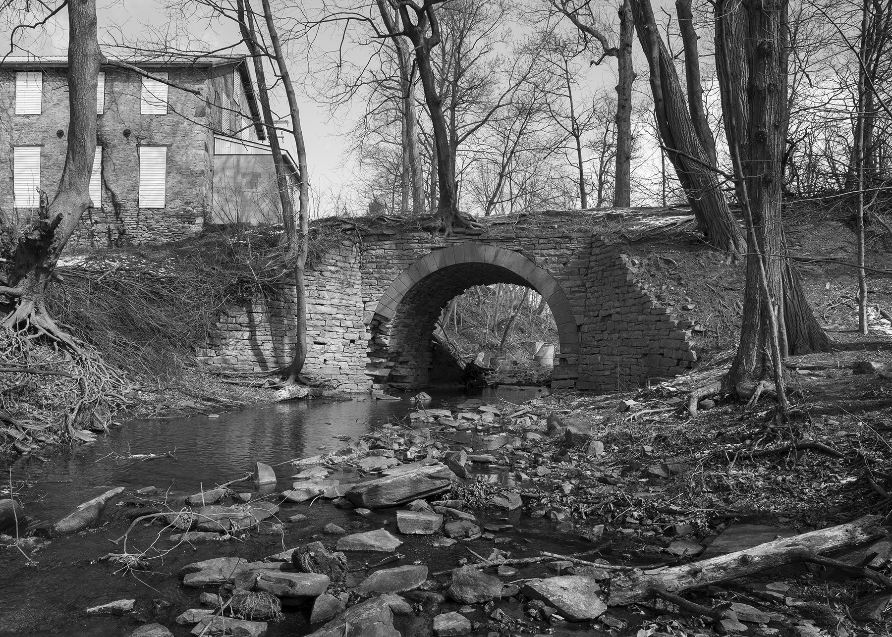 The remains of the original Philadelphia & Columbia stone arch bridge crossing Pine Creek still survive despite being part of the right of way that was abandoned during the 1890's line improvements between Gap and Atglen, Pennsylvania. The structures at the left are part of what was Christiana Machine, one of the first industries in Sadsbury Township to take advantage of the railroad's expanded market reach.