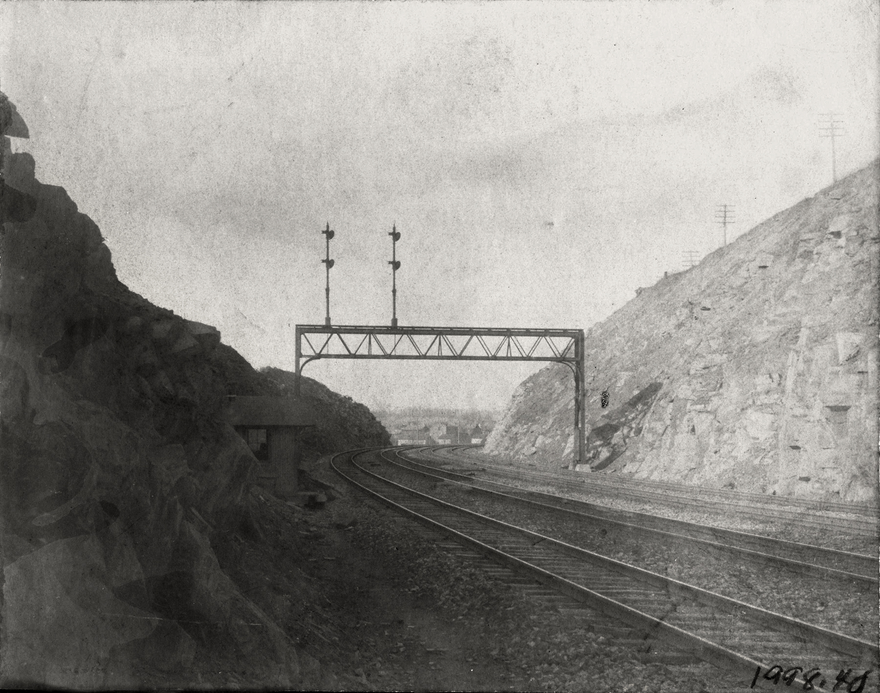 With Christiana in view, the distant signal to NI interlocking at Atglen stands prominently in this view looking west in the North Bend Cut around the turn of the century. Moores Memorial Library, Christiana, PA
