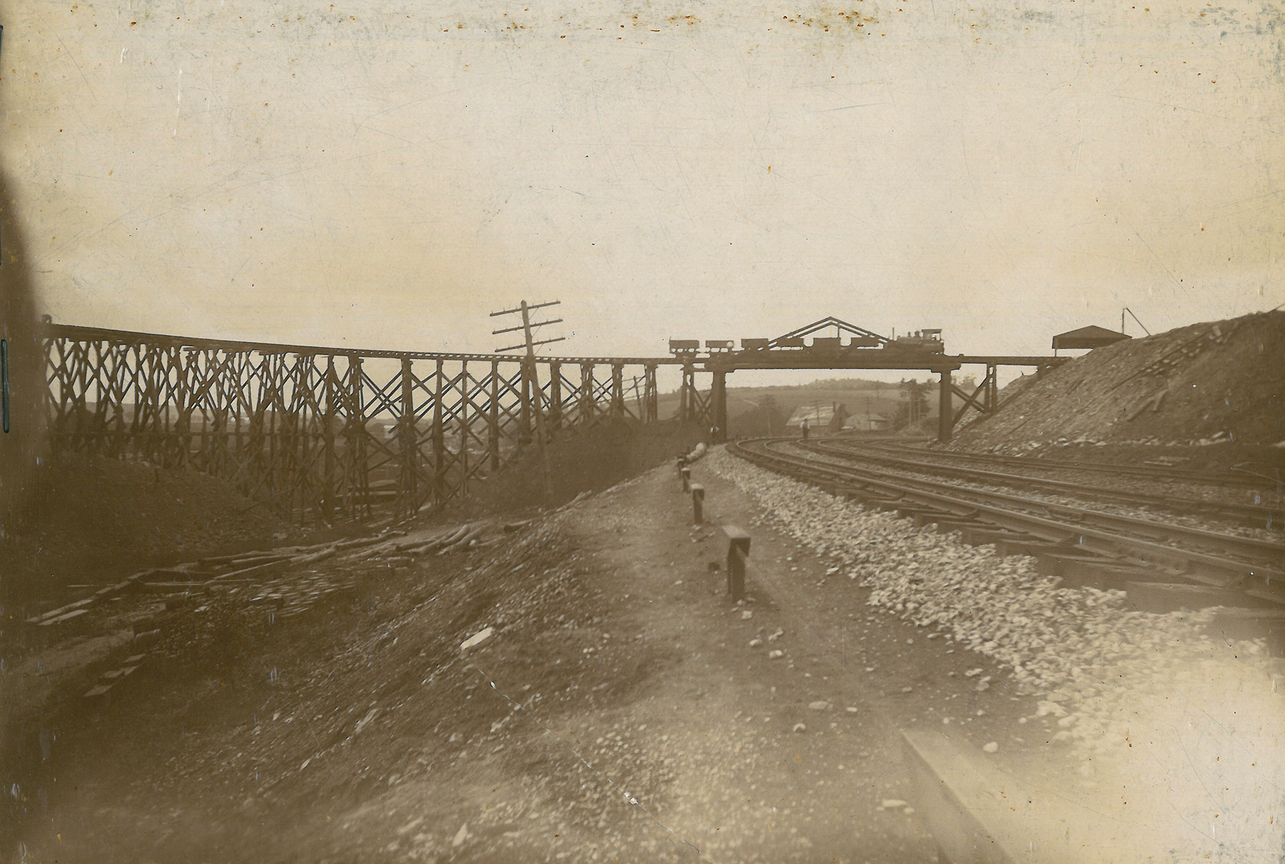 Charles Sims & Co, the contractor, tasked to construct the first seven miles of the A&S Branch erected this narrow-gauge railroad between an area near Zion Hill and the new Low Grade. The temporary line hauled material stored on local land holdings to the new elevated right of way, which required massive amounts of fill to maintain a gentle grade across the undulating landscape of Southern Lancaster County. Moores Memorial Library, Christiana, PA.