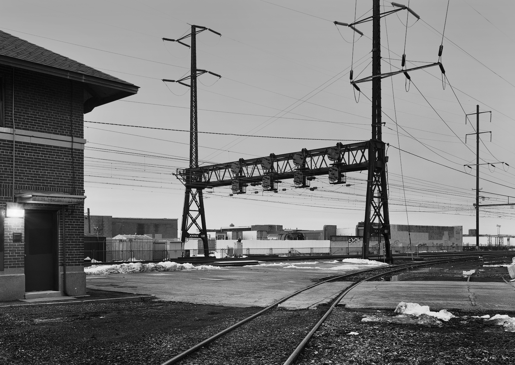 View of the westbound home signal, from the Bustleton Branch, Holmesburg section, Philadelphia, Pennsylvania. Holmesburg was an interlocking and commuter station along the main line and the location where the Bustleton Branch diverged. Countless locations alongside the railroad have a backstory, Photographs & History expands beyond the contemporary photograph to tell these stories.