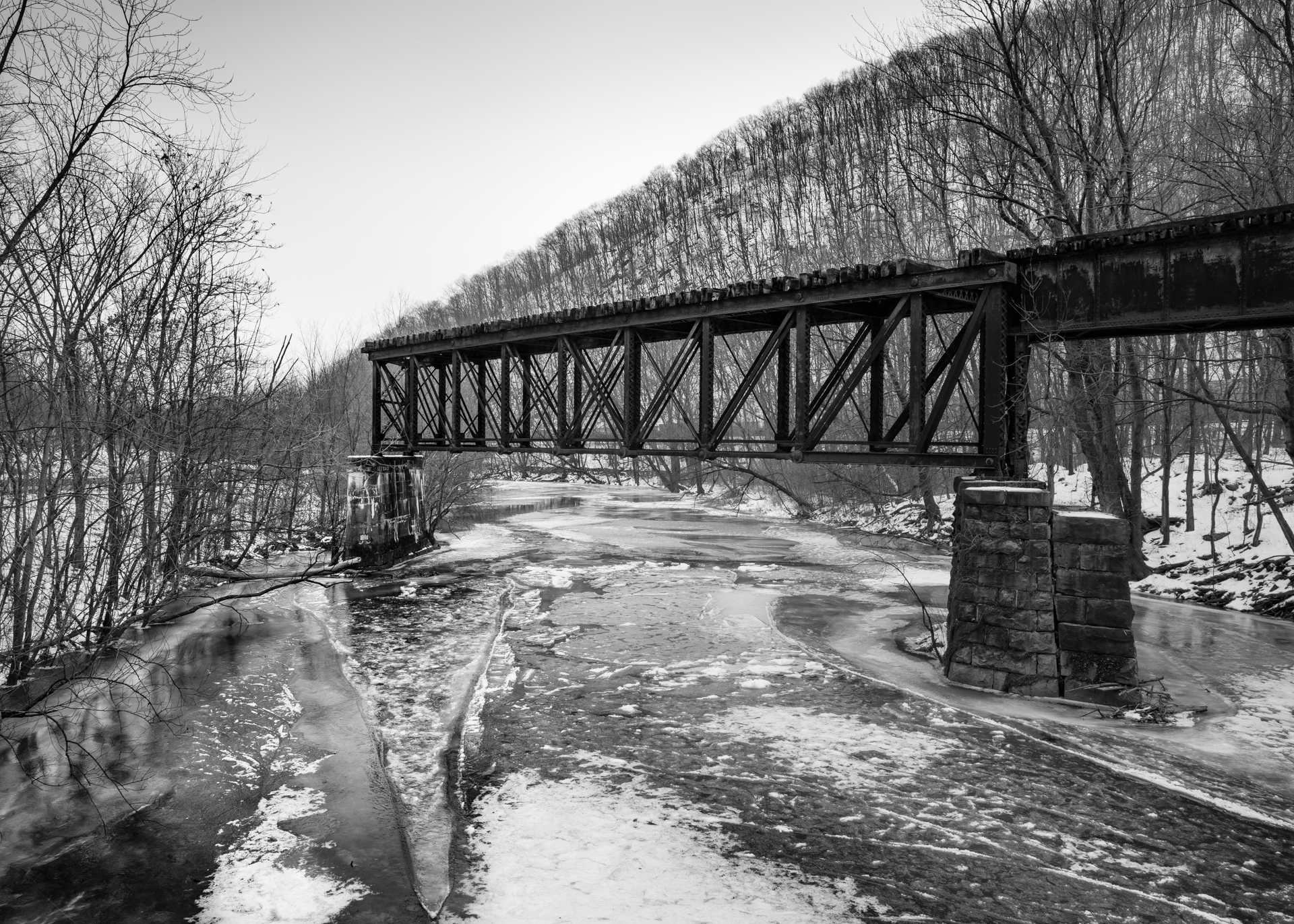 Abandoned Pratt Deck Truss Bridge, spanning the Little Juniata River, part of the remains of the former Lewisburg & Tyrone Railroad, a PRR subsidiary.