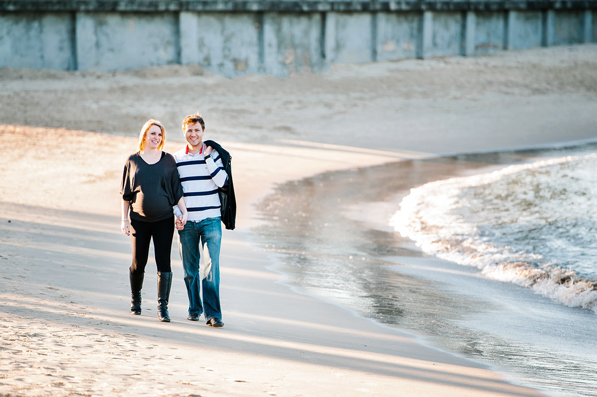 Couple walking on Balmoral beach during maternity session