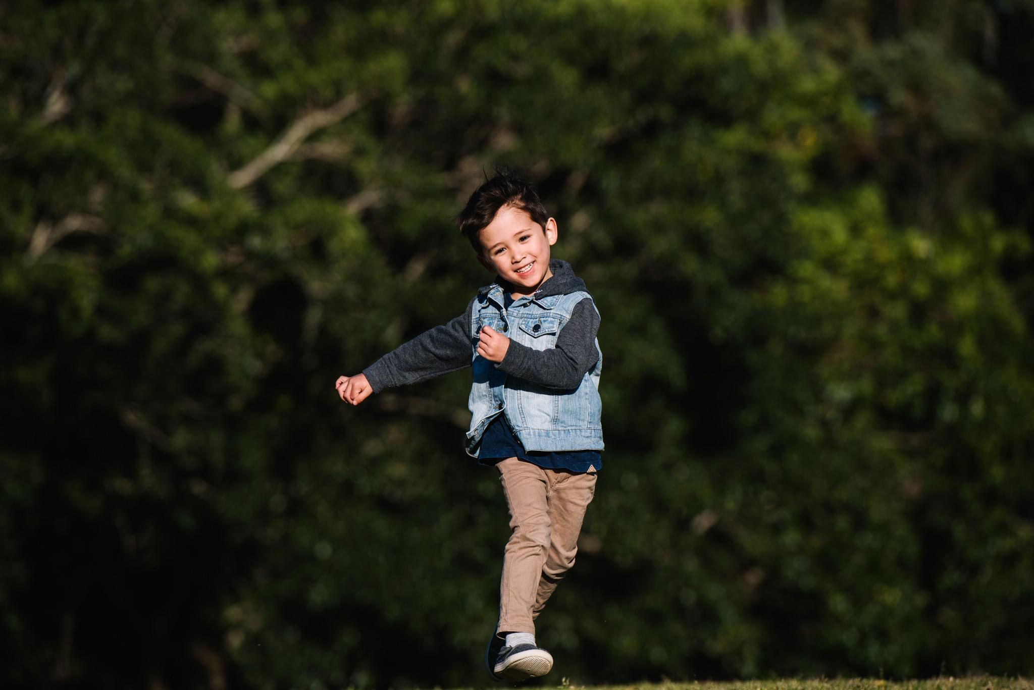 Boy running and leaping in the air