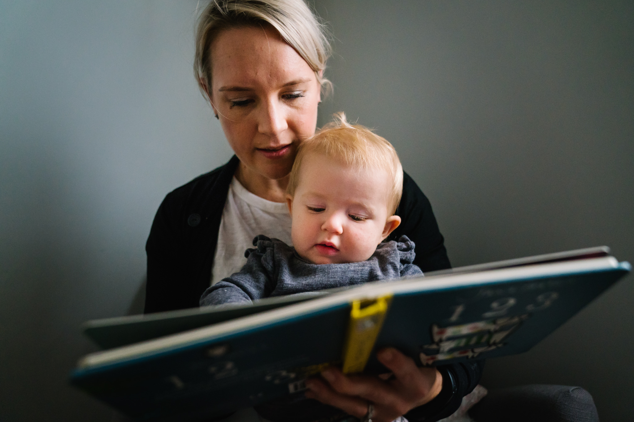 Baby and mum reading