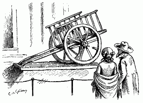 museum-display-of-a-cart-wagon-with-broken-spoke-in-wheel.png