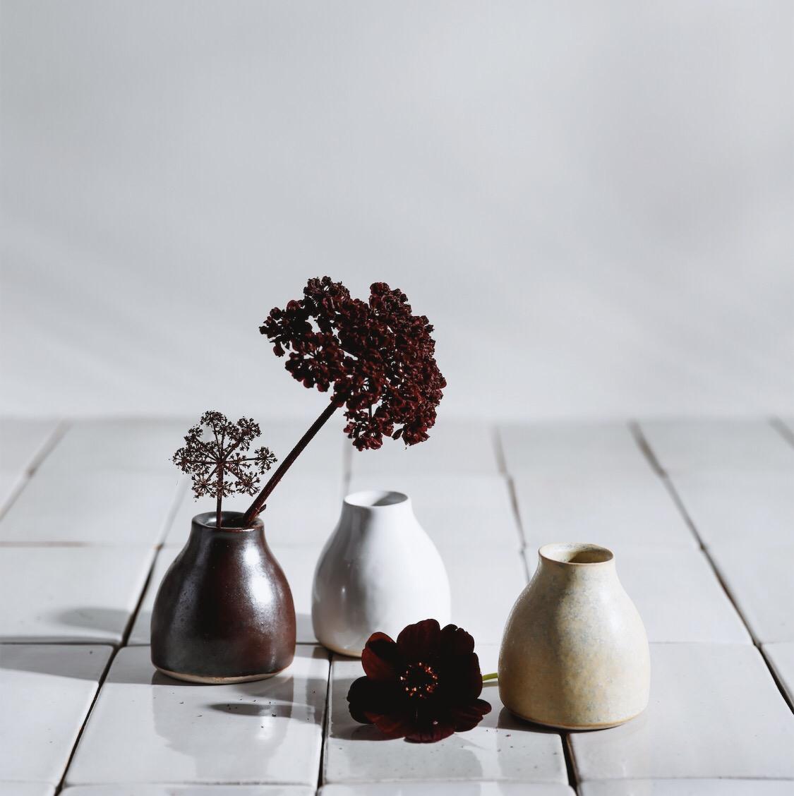 bud vases by  Sarah Kersten