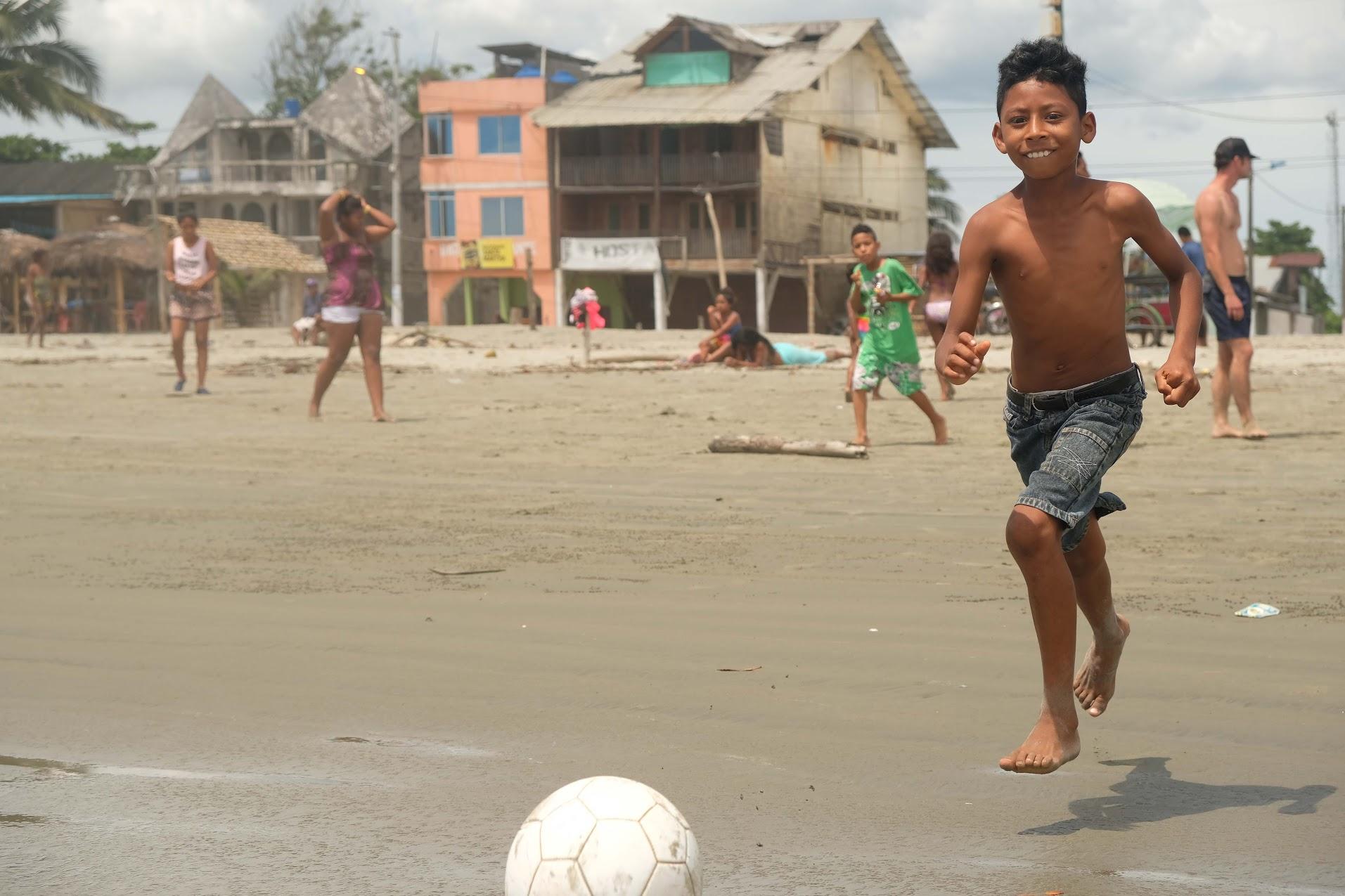 Levitating on the beach in Ecuador.