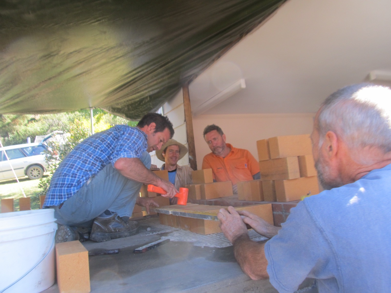 Damon, Graham, James and Les working on the hearth.