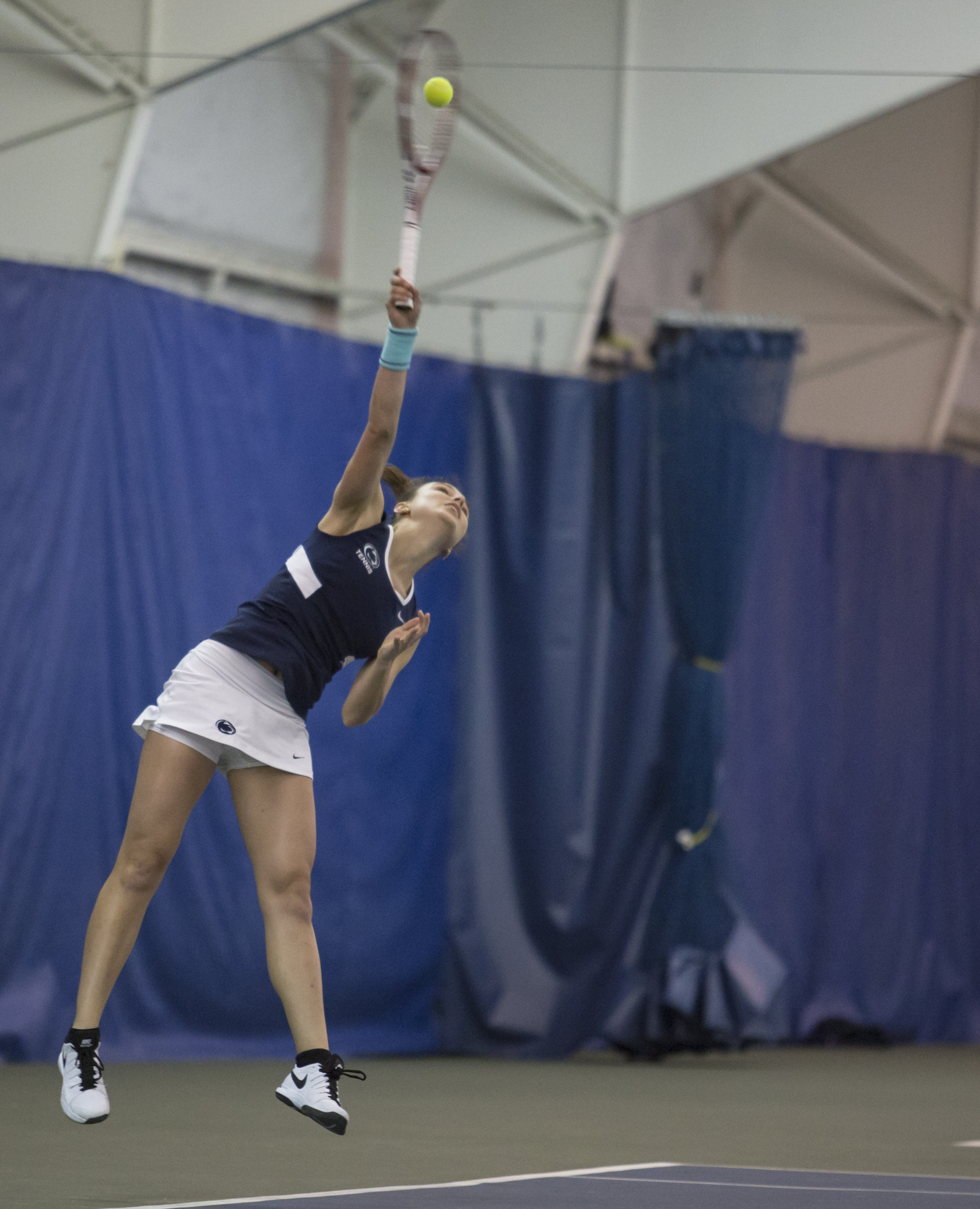 Devan McClusky lunches to return a volley during the doubles match against Nebraska at the Indoor Tennis Facility on Friday, April 8, 2016.
